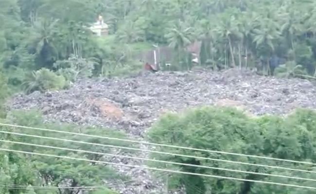 Waste from landfill slides down with rainwater in Mangaluru, enters homes and farms
