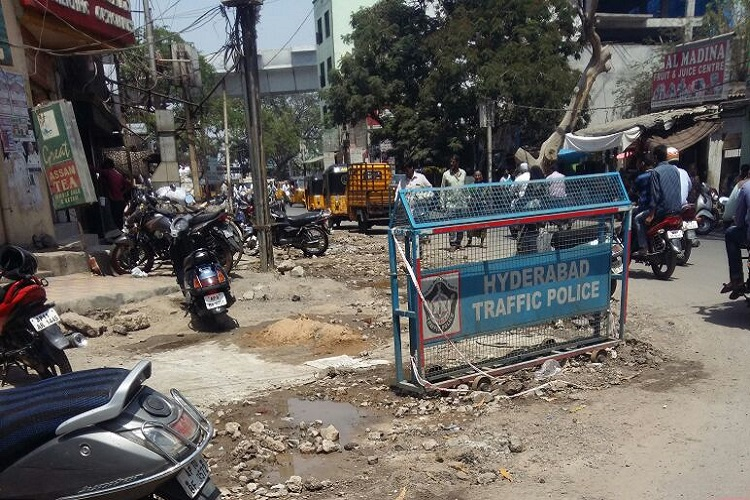 Dug-up roads, dust and sewage waste leave Hyderabad residents