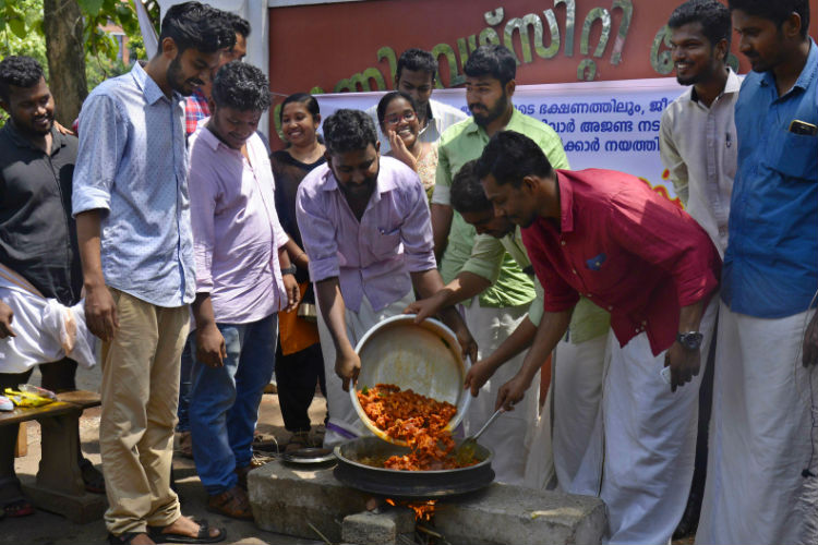 Image result for SFI students participated in trivandrum beef fest
