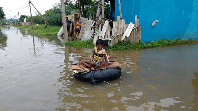 Residents of Chennai flee flooded homes as rains continue