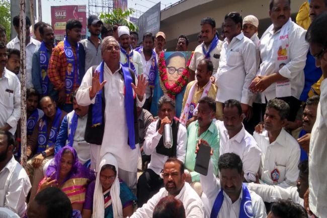 "c63009411468 Speaking at the protest, Madiga Reservation Porata Samithi, president Manda  Krishna Madiga said, ""We won't leave the venue until the statue is restored."
