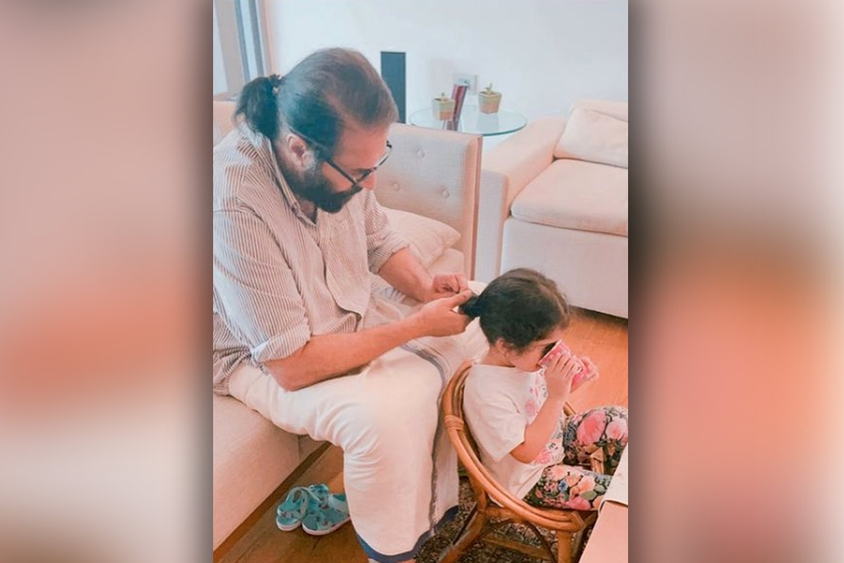 Dulquer posts cosy picture of Mammootty with grandchild for Fathers Day