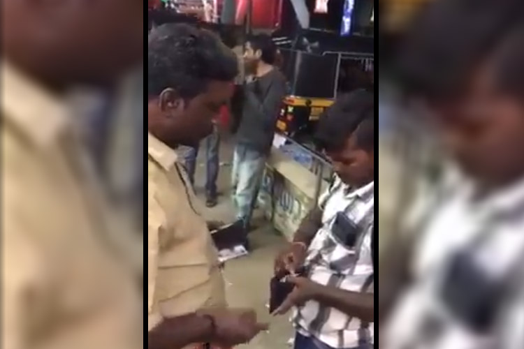 Kerala man caught on cam demanding Aadhaar from migrant labourer and slapping him