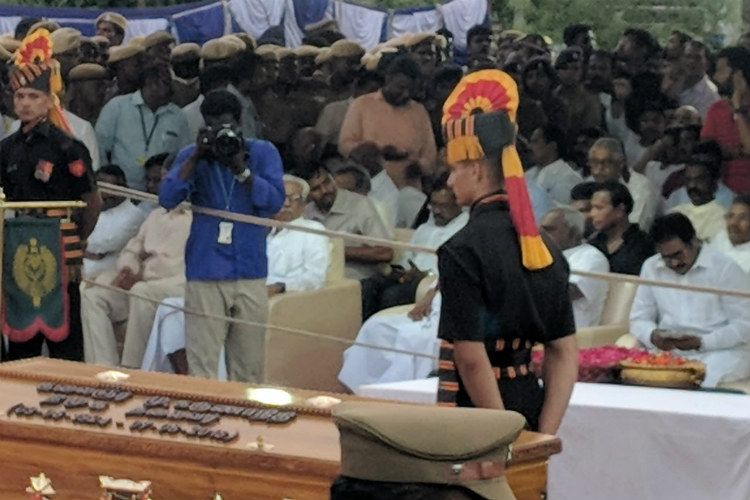 In the company of Anna, Kalaignar laid to rest at Marina