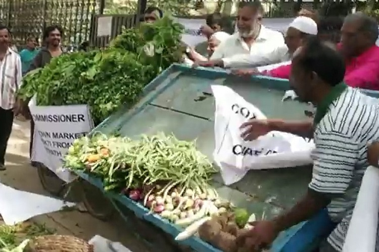 Bengaluru Cox Town vendors throw vegetables on street in protest against BBMP