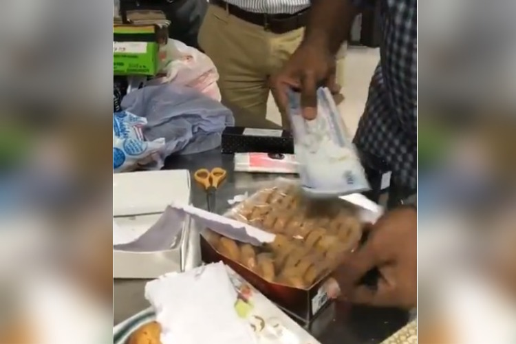 Watch: Foreign currency worth Rs 1.48 cr being smuggled in biscuit boxes seized in Hyd