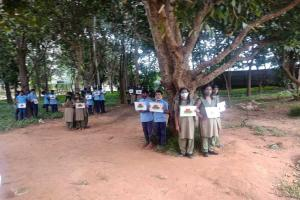 Bengaluru students hug trees to prevent their axing for road widening