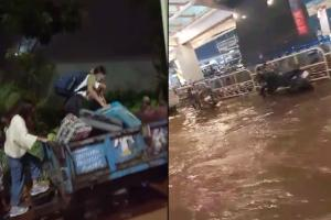 Bengaluru airport area flooded after heavy rains stranded passengers use tractors
