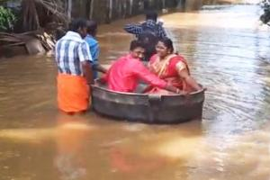 Roads flooded this Kerala couple used a cooking vessel to reach their wedding