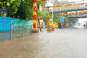 Mumbai rains Local train services affected roads flooded after downpour