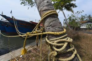 In Keralas Munambam adverse conditions push native fishermen to sell their boats
