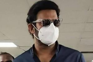 Prabhas obliges fans for photos at Hyderabad govt office while wearing mask