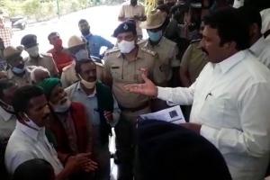 Video Karnataka Agri Min BC Patil confronted by protesting Mysuru farmers