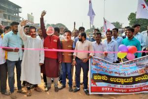 Left activists wearing Modi Gadkari masks inaugurate incomplete Ktaka flyover