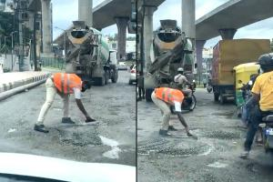 Watch Bengaluru traffic cop who filled pothole earns praise after viral video