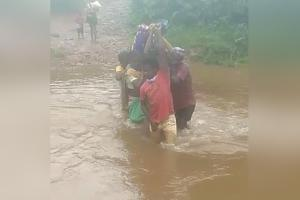 Andhra rains Pregnant woman carried by relatives to cross rivulet to reach hospital
