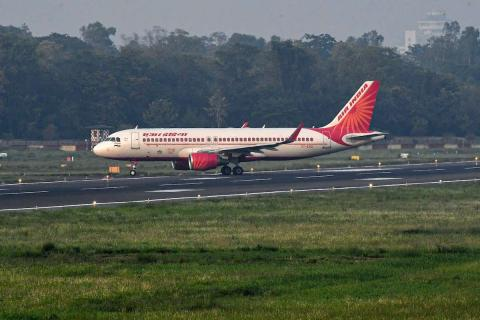 A picture of a plane with an Air India logo on a runway