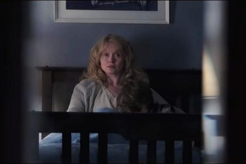 Amelia from The Babadook sitting in bed