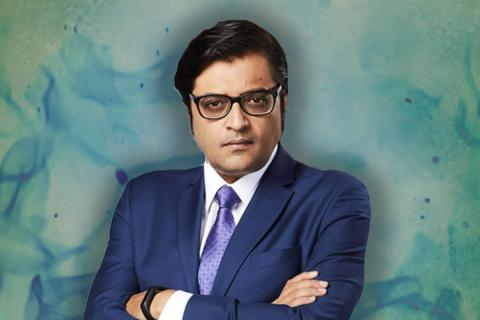 Republic TV Editor in Chief Arnab Goswami wearing a suit and looking into camera with hands crossed