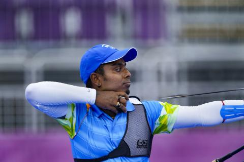 Atanu Das aims in an archery match at the Tokyo Olympics
