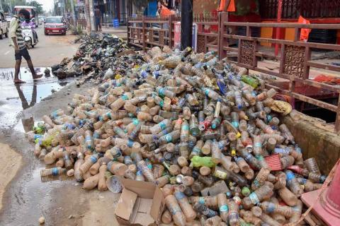 Plastic bottles recovered from sewers are seen at a road, during cleaning of drains with the onset of Monsoon, amid the COVID-19 nationwide lockdown,