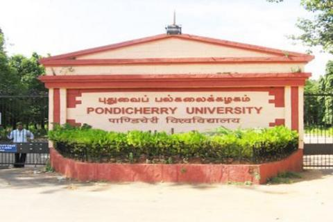 A pillar with the name of Pondicherry University inscribed on it