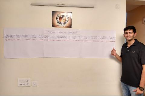 Rahul Muralikrishnan from Bangalore stands next to the subtraction of 100 digit numbers