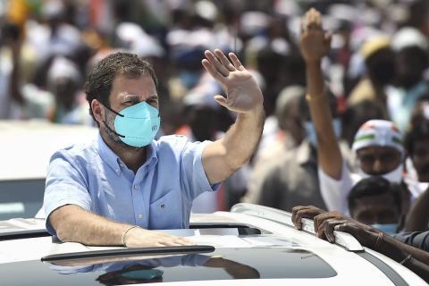 Rahul Gandhi in a vehicle campaigning in Tamil Nadu