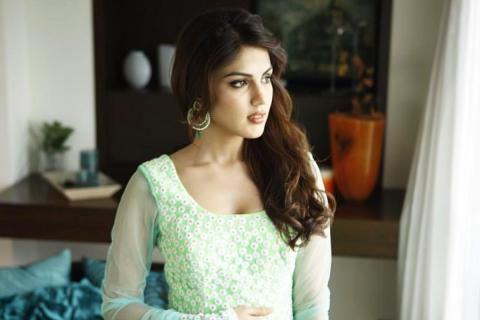 Actor Rhea Chakraborty wearing a green kurta and looking to her left