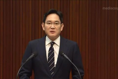 Samsung's Lee Jae-yong standing at a podium and speaking.