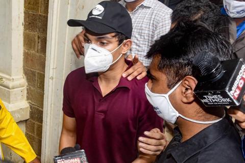 Showik Chakraborty, brother of Bollywood actress Rhea Chakraborty, wearing a maroon shirt and a mask