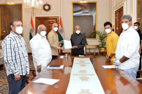 A delegation of TDP leaders meeting with President Ram Nath Kovind wearing masks and submitting a representation with complaints on YSRCP