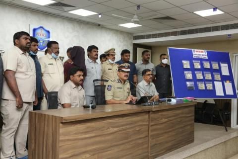 Hyderabad police with accused person who had impersonated KTRs personal secretary