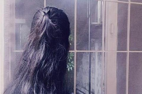Representative image of a silhouette of a woman where the back of her head can be seen