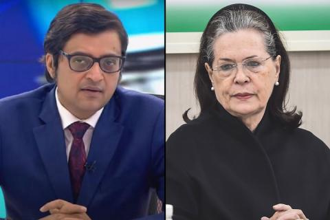 Arnab Goswami on the left in blue blazer and red tie and Sonia Gandhi in black on the right