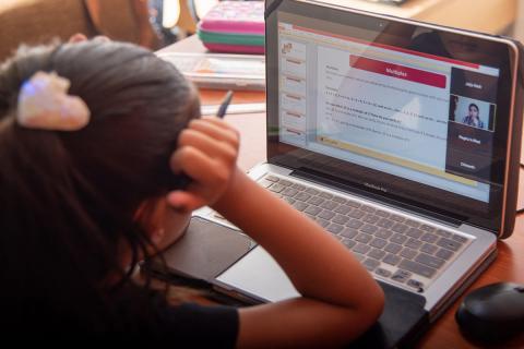 A girl attending online classes