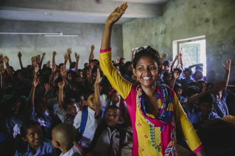 Woman leader of Bandhan Mukti, a survivors' collective, posing after a school sensitisation workshop
