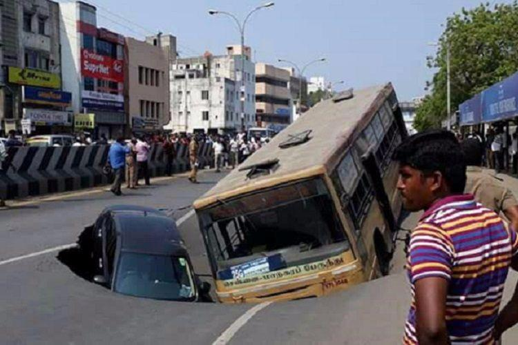 Chennais Anna Salai caves in trapping bus and car in giant crater