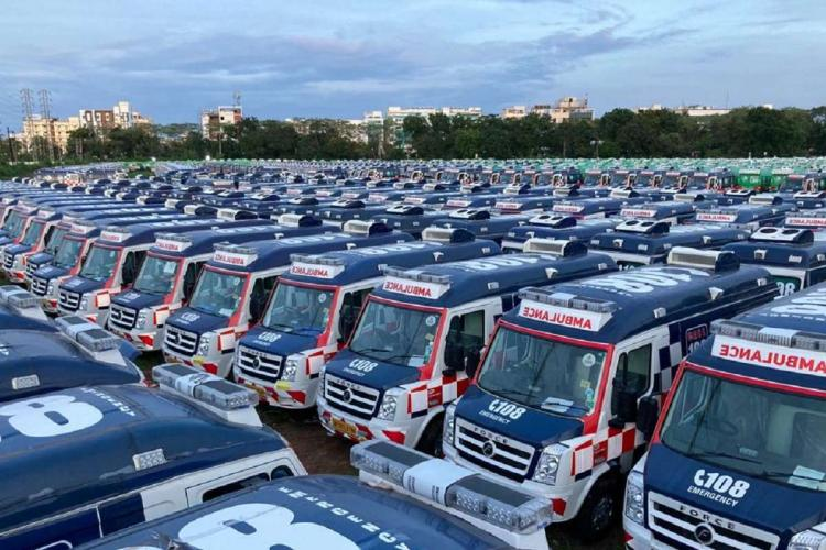 Ambulances of the 108 and 104 services parked in an open ground in Andhra Pradesh