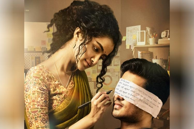 Anupama Parameswaran writes on a paper which is used as a blindfold for Nikhil Siddhartha