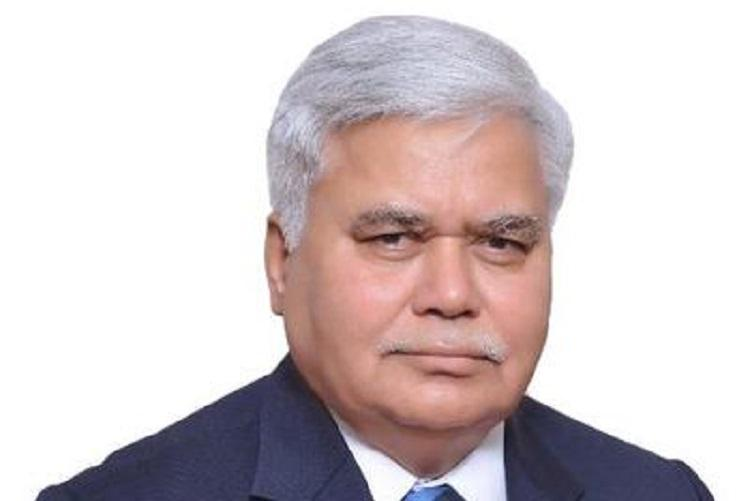 TRAI chief shares Aadhaar publicly dares hackers Predictably his details leaked