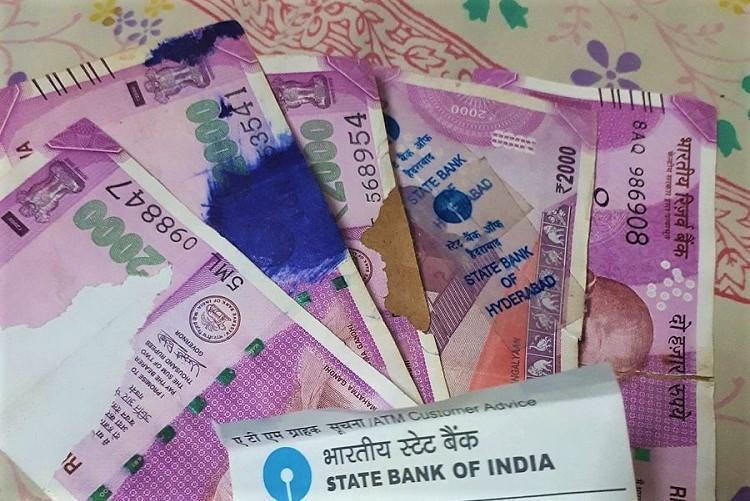 SBI ATM dispenses torn Rs 2000 notes in Hyderabad resident files complaint