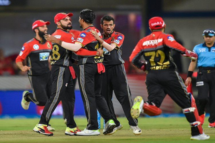 Bangalore trounce Punjab by 10 wickets keep play-off hopes alive