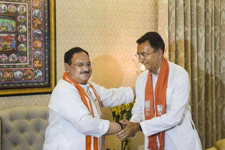 BJP National President JP Nadda greets Jatin Prasada after he joined BJP at his residence in New Delhi Wednesday June 9 2021