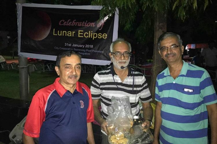 Munching away the myths Mangalurus rationalists distribute snacks during eclipse