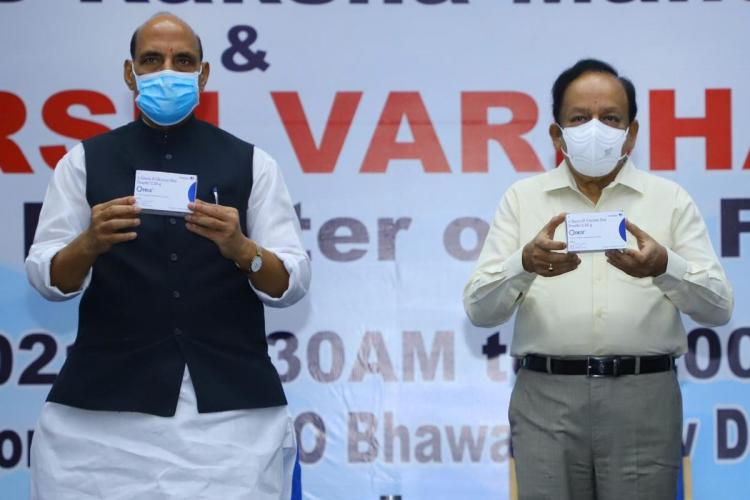 Defence Minister Rajnath Singh and Health Minister Harsh Vardhan holding up DRDOs anti COVID oral drug 2-DG