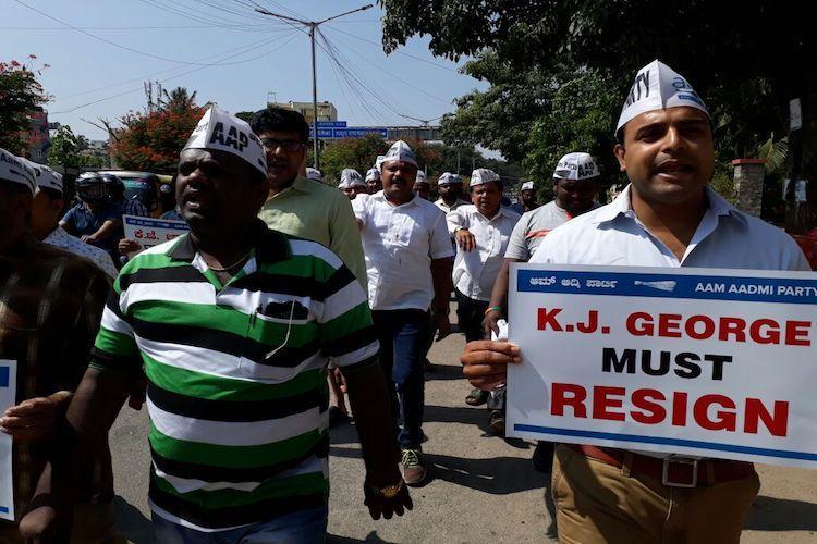 KJ George behaving like King George AAP demands Ktaka ministers resignation