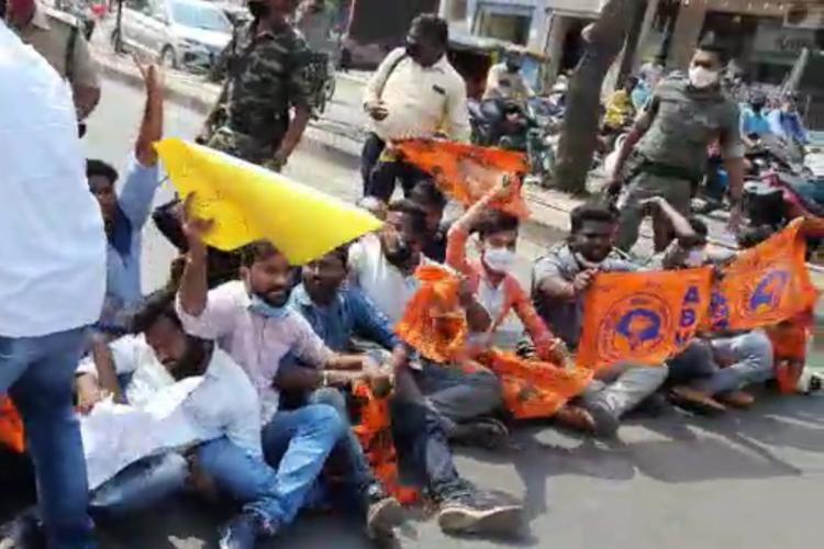 ABVP activists blocking the road holding placards and ABVP flags