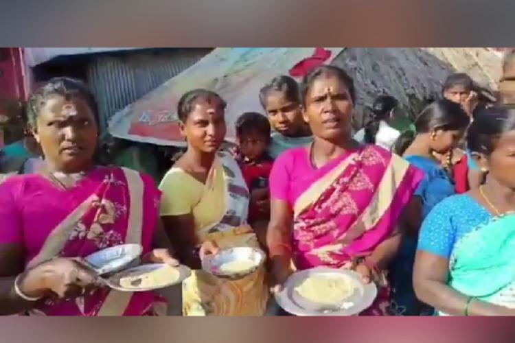 Women standing with aarthi plate filled with poor quality rice to welcome AIADMK MLA