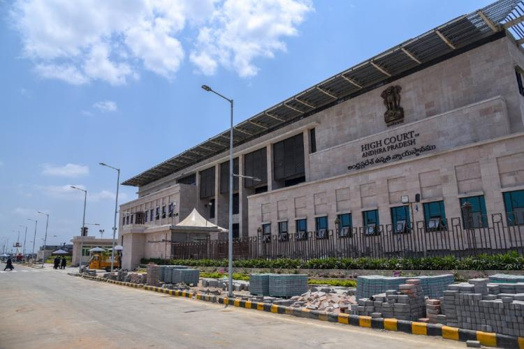 Wide view of Andhra Pradesh High Court building in Amaravati with a clear blue sky in the backdrop